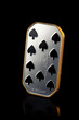 ten of spades. silver coin isolated on black