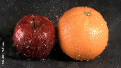 Water sprayed on fruits in super slow motion