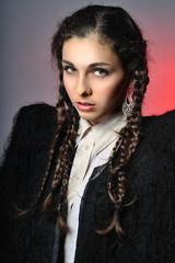 Studio portrait of the nice young Caucasian girl