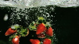 Strawberries underwater in super slow motion
