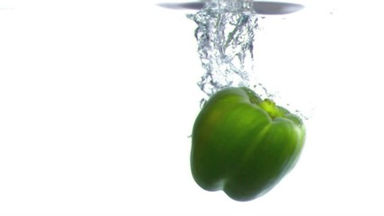 Pepper dropped into water in super slow motion