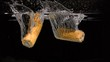 Corn cobs falling into water in super slow motion