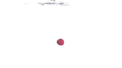 Raspberry falling into water in super slow motion