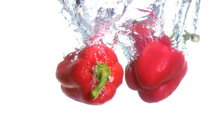 Peppers falling into water in super slow motion