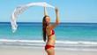 Brunette raising a sarong