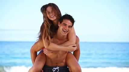 Man giving his girlfriend a piggy-back