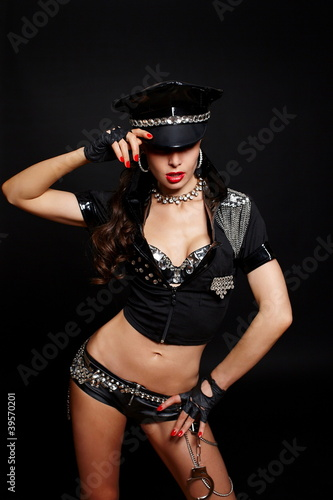 sexy  semi nude police woman with long curly hair