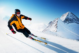 Fototapety Skier in mountains, prepared piste and sunny day