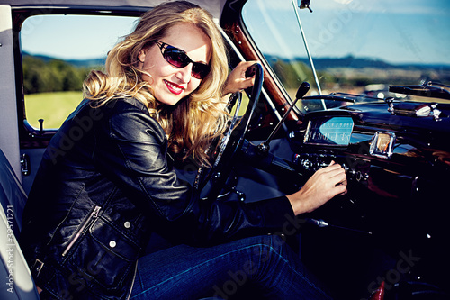 Girl in front of Post-War classic car