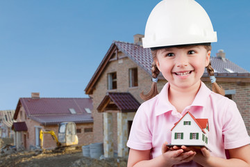 Family house concept - lovely girl with house model