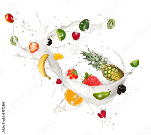 Fruits pieces falling in milk splash,isolated on white