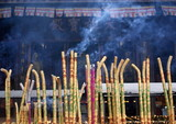 Incense and candles at a Buddhist temple, Sichuan, China