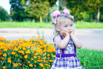 Pensive girl in a flower meadow