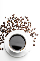 cup of coffee with coffee grains isolated on white