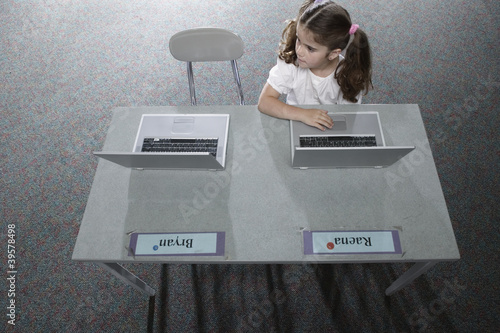 Girl in classroom with laptop