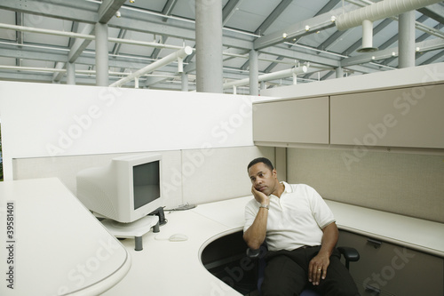 Sad businessman in empty office