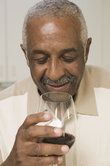 Man drinking glass of wine