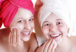 Two teenage girlfriends care for the face skin