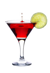 Cocktail with falling drop and lime slice isolated on white