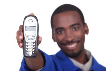 Afro man holding phone on white background