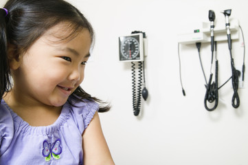 Young girl sitting in a doctor's office