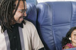 Father with young daughter on airplane