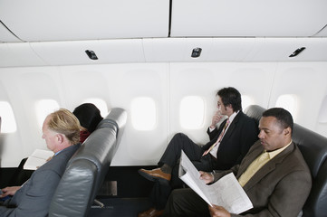 High angle view of businessmen traveling in an airplane