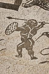Darstellung eines Kriegers in römischem Mosaik