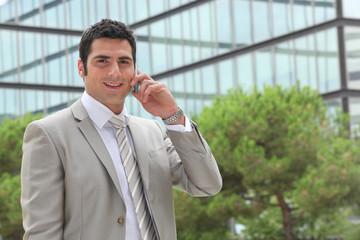 Banker having phone call outdoors