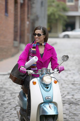 Young woman driving a scooter