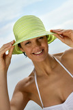 Woman wearing bikini and hat