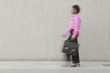 Blurred view of businesswoman walking with briefcase