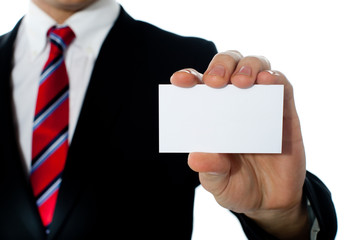 Closeup shot of a man showing business card