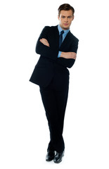 Handsome business executive tilting