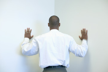 Businessman leaning into corner