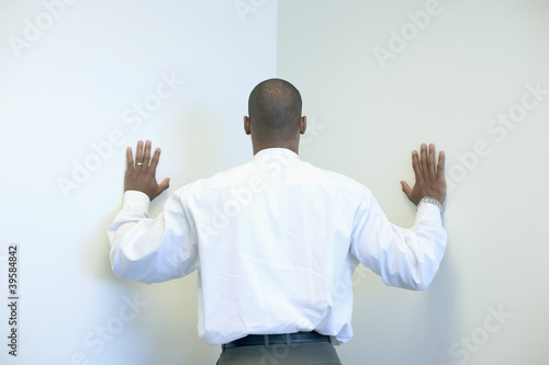 Businessman leaning into corner