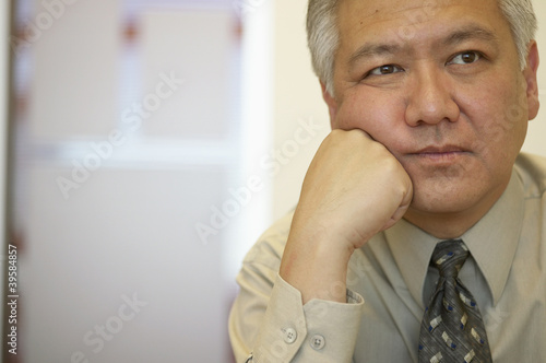 Businessman relaxing on fist