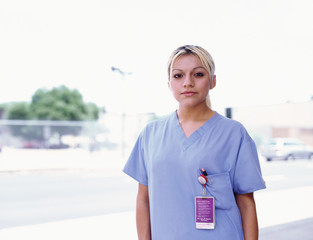 Young female nurse outdoors
