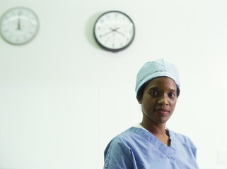 Female surgeon with clocks on wall