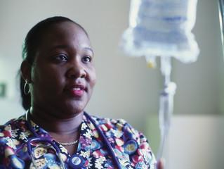 Female nurse adjusting intravenous drip