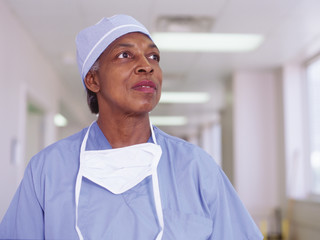 Female surgeon in hospital hallway
