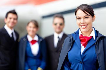 Flight attendant with cabin crew