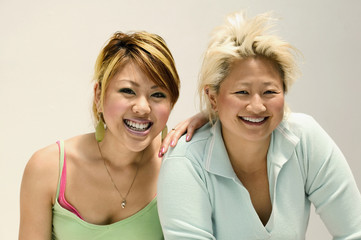Two Asian women with blonde hair