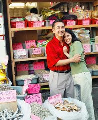 Young couple hugging in Asian market