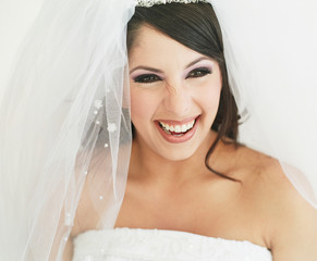 Young bride laughing