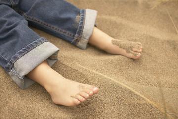 Toddler's feet in sand