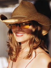 Young woman in hat and sunglasses