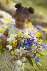 Young girl with fresh flower bouquet