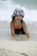Young girl in ocean at beach