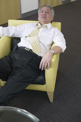 Mature businessman sleeping